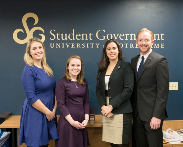 McKenna Schuster (left), Sam Moorhead, Lauren Vidal and Matthew Devine worked to enhance community on their respective campuses through the 29 for 29 program at Notre Dame and the SMC card initiative.