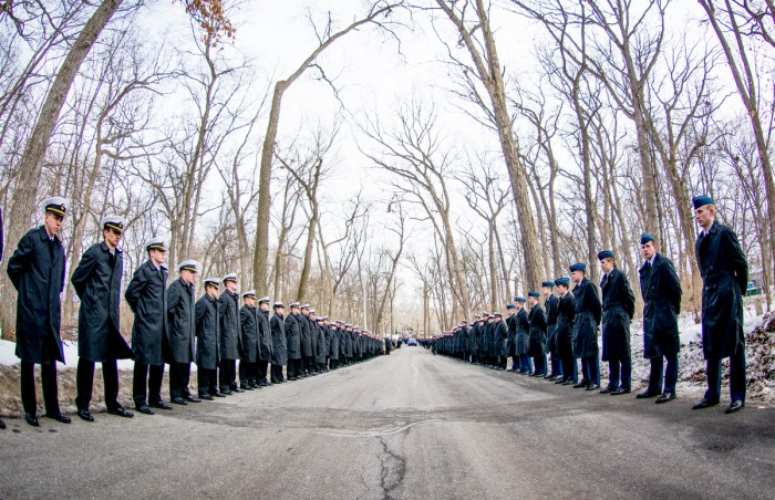 University midshipmen (left) and cadets (right) line Saint Mary's Road to honor the life of Fr. Hesburgh during the funeral procession March 4. Many students, faculty and staff joined the procession.