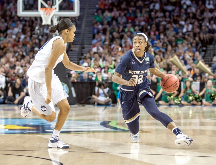 Irish junior guard Jewell Loyd drives against Connecticut junior guard Moriah Jefferson during Notre Dame's 63-53 loss in the national championship. Loyd finished the game with 12 points and five rebounds.