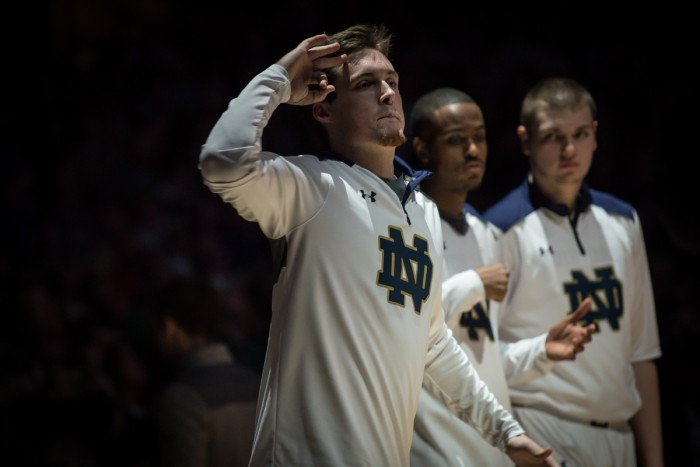 Irish senior captain Pat Connaughton greets his teammates during introductions before Wednesday's game.