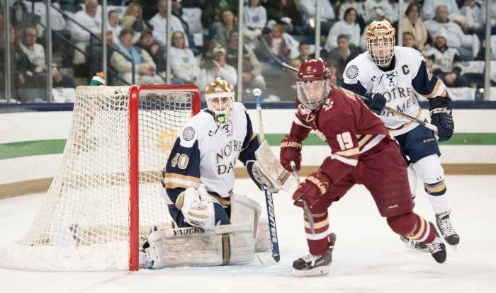 Irish freshman goaltender Cal Petersen and junior center Steven Fogarty track the puck in Notre Dame's 2-0 loss to Boston College.