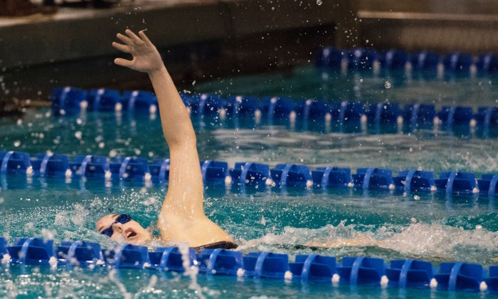 Senior Courtney Whyte comes up for air during a meet against Purdue on Nov. 1 at Rolf's Aquatic Center. Whyte finished second in the 200-yard backstroke during the meet.