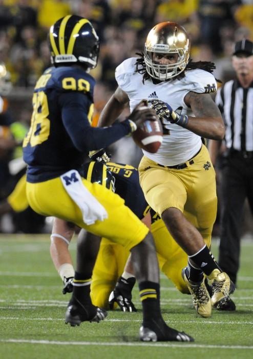 Former Irish defensive lineman Ishaq Williams rushes former Michigan quarterback Devin Gardner during Notre Dame's 41-30 loss to Michigan at Michigan Stadium on Sept. 7, 2013.