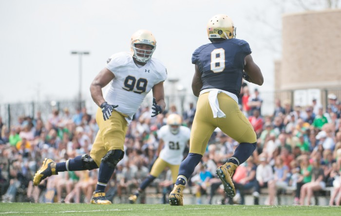 Freshman defensive lineman Jerry Tillery rushes junior quarterback Malik Zaire during the Blue-Gold Game on April 18.