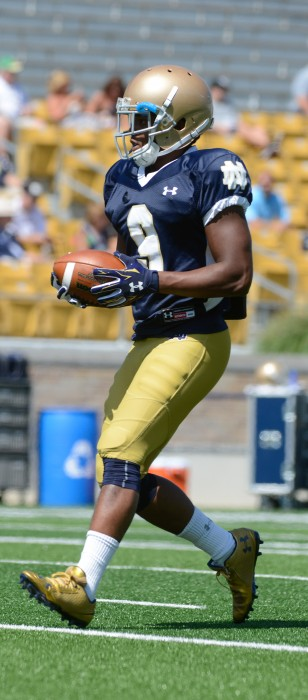 Irish freshman receiver C.J. Sanders finishes a route during practice at Notre Dame Stadium on Aug. 21.
