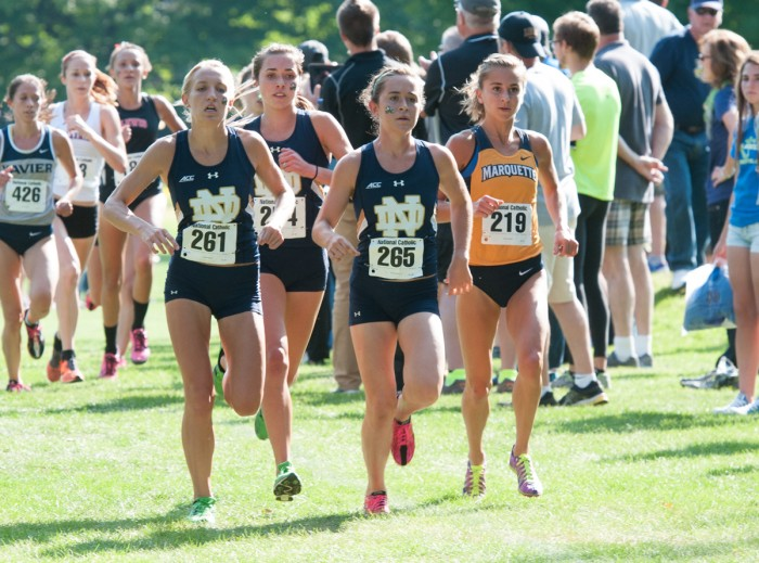 Senior Molly Seidel leads the pack before finishing first at the National Catholic Championships on Sept. 19, 2014. Senior Danielle Aragon finished second, and the Irish won the team title outright.