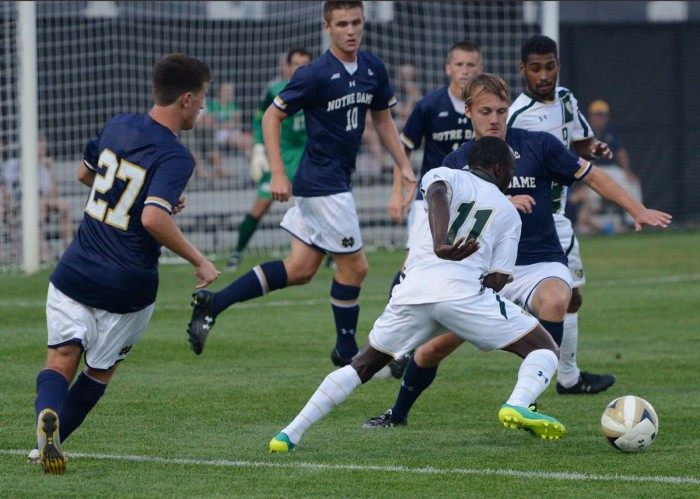 EMILY KRUSE | The Observer Irish graduate student defender Max Lachowecki fights for the ball during Friday's 2-0 win over South Florida at Alumni Stadium.
