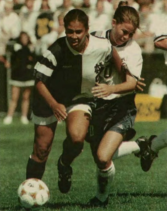 Shannon Boxx dribbles down the field in a game while at Notre Dame. Boxx competed for the Irish from 1995 to 1998. She was a part of the Notre Dame squad that won the program's first national title in 1995.