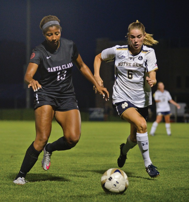 Senior forward Anna Maria Gilbertson fights for a loose ball in Notre  Dame's 2-1 victory against Santa Clara on Aug. 28.