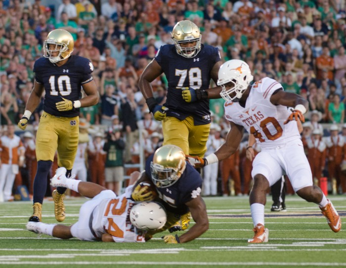 Senior offensive lineman Ronnie Stanley hustles after the play during Notre Dame's 38-3 Victory against Texas on Sept. 5.
