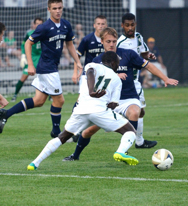 Irish graduate student defender Max Lachowecki, center, challenges for the ball during Notre Dame's 2-0  victory over South Florida on Sept. 4 at Alumni Stadium. The Irish have not conceded any goals this season.