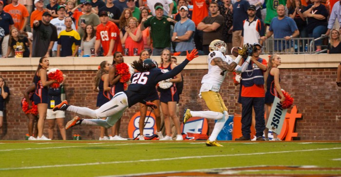 Irish junior receiver Will Fuller hauls in the game-winning touchdown reception with 12 seconds left to push Notre Dame past Virginia 34-27 at Scott Stadium in Charlottesville, Virginia, on Saturday. The Irish twice led by double digits but needed a late-game drive led by sophomore quarterback DeShone Kizer to top the unranked Cavaliers.