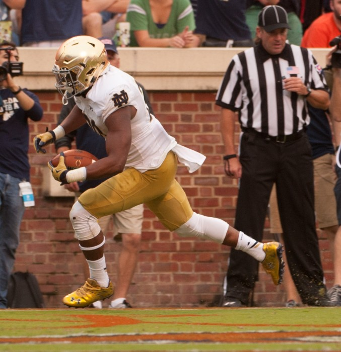 On DeShone Kizer's first snap against Virginia, senior running back C.J. Prosise scores from 24 yards out in the third quarter.