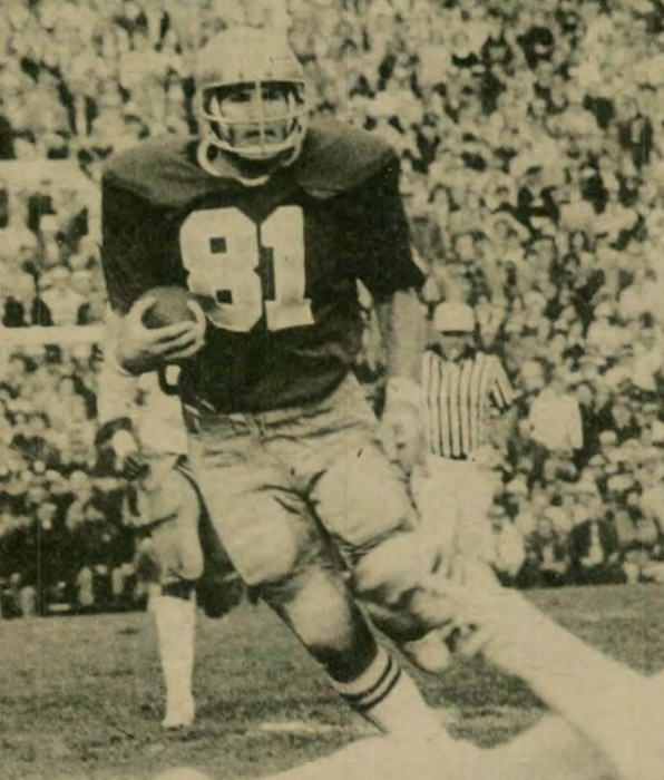 Irish tight end Ken MacAfee carries the ball during the 1976 season. MacAfee played for Notre Dame from 1974 to 1977. He was a three-time All-American and the 1977 Walter Camp Player of the Year.