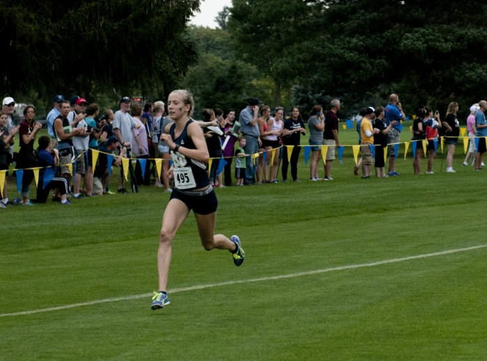 Freshman Anna Rohrer distances herself from the pack during her  first-place finish at Friday's National Catholic Championships.