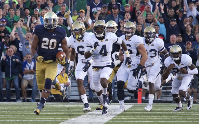 Irish senior running back C.J. Prosise leaves the Georgia Tech defense in his wake during his 91-yard, fourth-quarter touchdown run in Notre Dame's 30-22 win Saturday. The touchdown run, Prosise's third of the game, was the longest in Notre Dame Stadium history, and pushed him over 200 multipurpose yards for the contest.