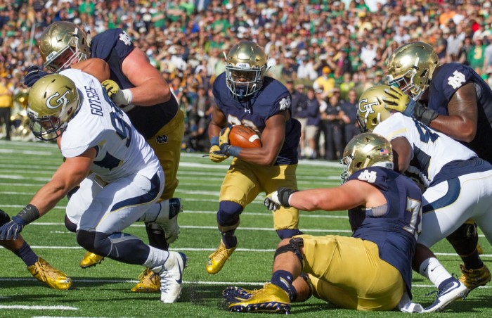 Senior running back C.J. Prosise runs through a hole in Notre Dame's victory over Georgia Tech on Saturday on his way to 198 rushing yards.