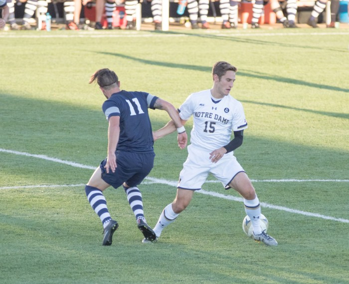 Irish senior midfielder Evan Panken dribbles around an Xavier defender in Notre Dame's 1-0 loss to Xavier on Sept. 15. Panken tied for the Irish lead with three shots during the contest.