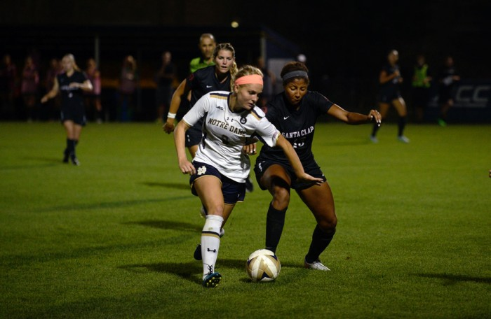 Irish freshman forward Natalie Jacobs dribbles past a defender during Notre Dame's 2-1 win over Santa Clara on Aug. 28.