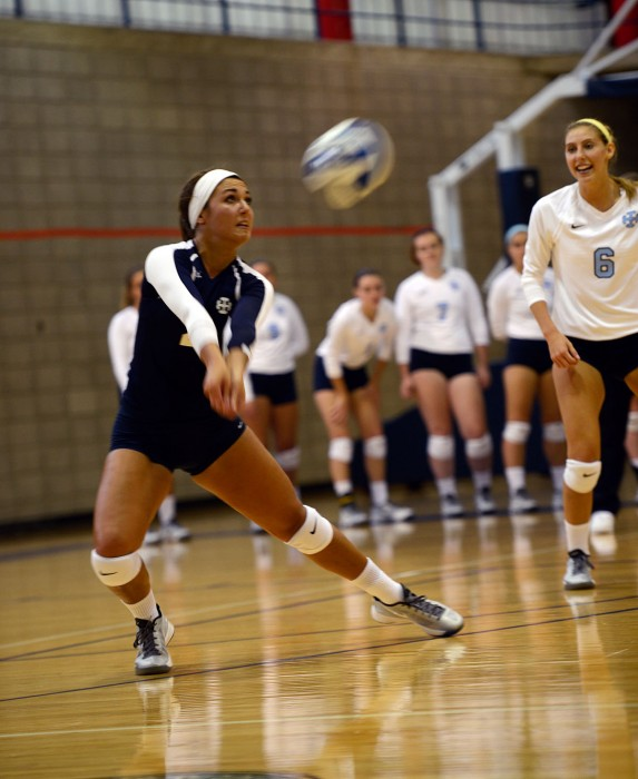 Belles sophomore libero McKenzie Todd bumps the ball during Saint Mary's 3-0 win over Manchester on Sept. 1 at Angela Gym. Todd finished the game with four digs.