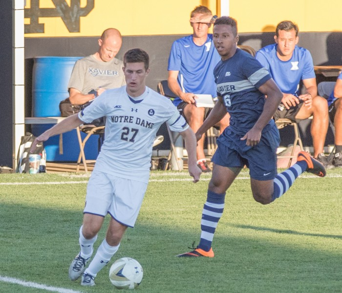 Senior midfielder Patrick Hodan turns away from a defender in a 1-0 loss to Xavier on Sept. 15 at  Alumni Stadium.