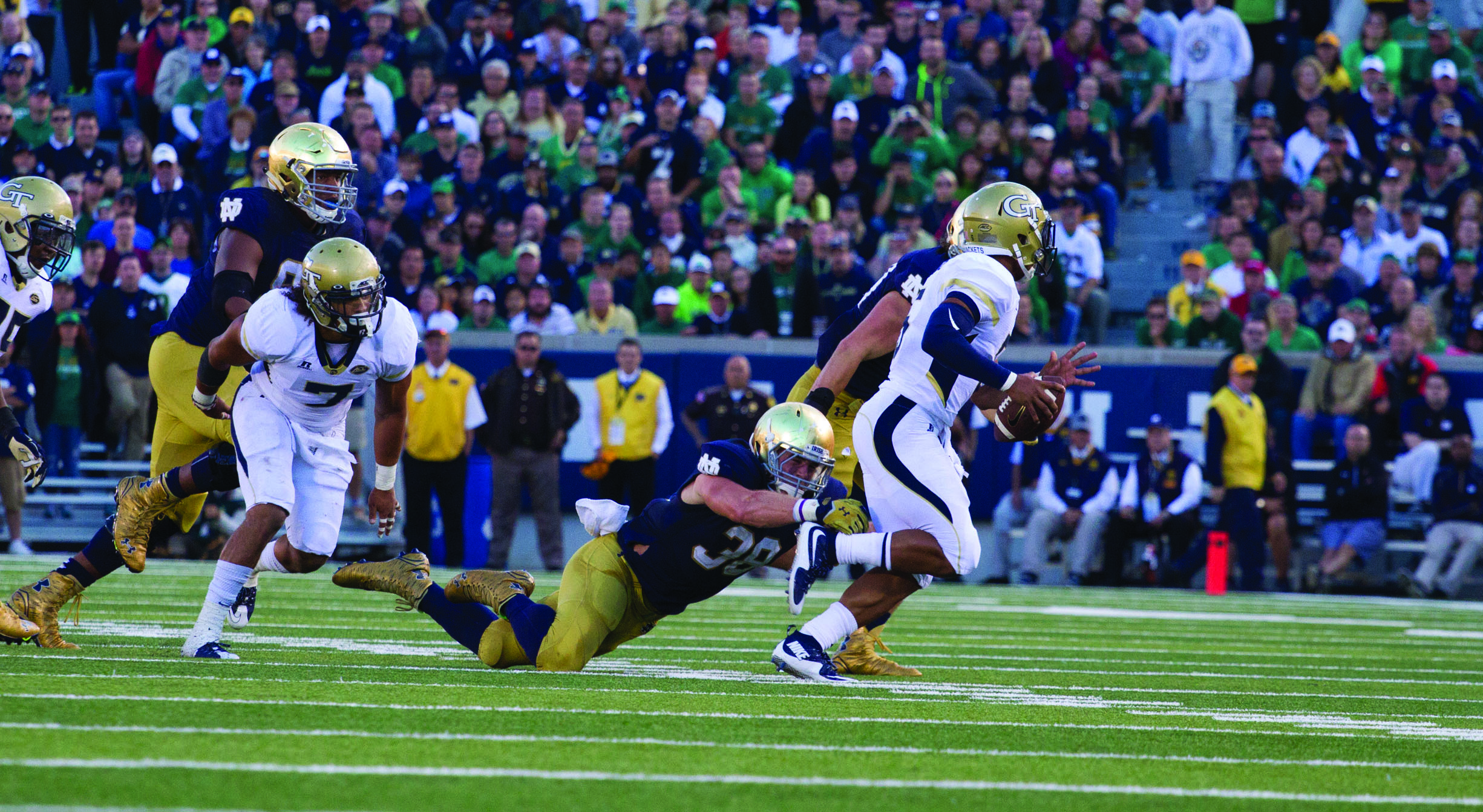 Irish graduate student linebacker Joe Schmidt, right, dives in an attempt to tackle Georgia Tech redshirt junior quarterback Justin Thomas during Notre Dame's 30-22 win at Notre Dame Stadium on Saturday. Schmidt led the Irish defense with 10 tackles, including two for a loss.