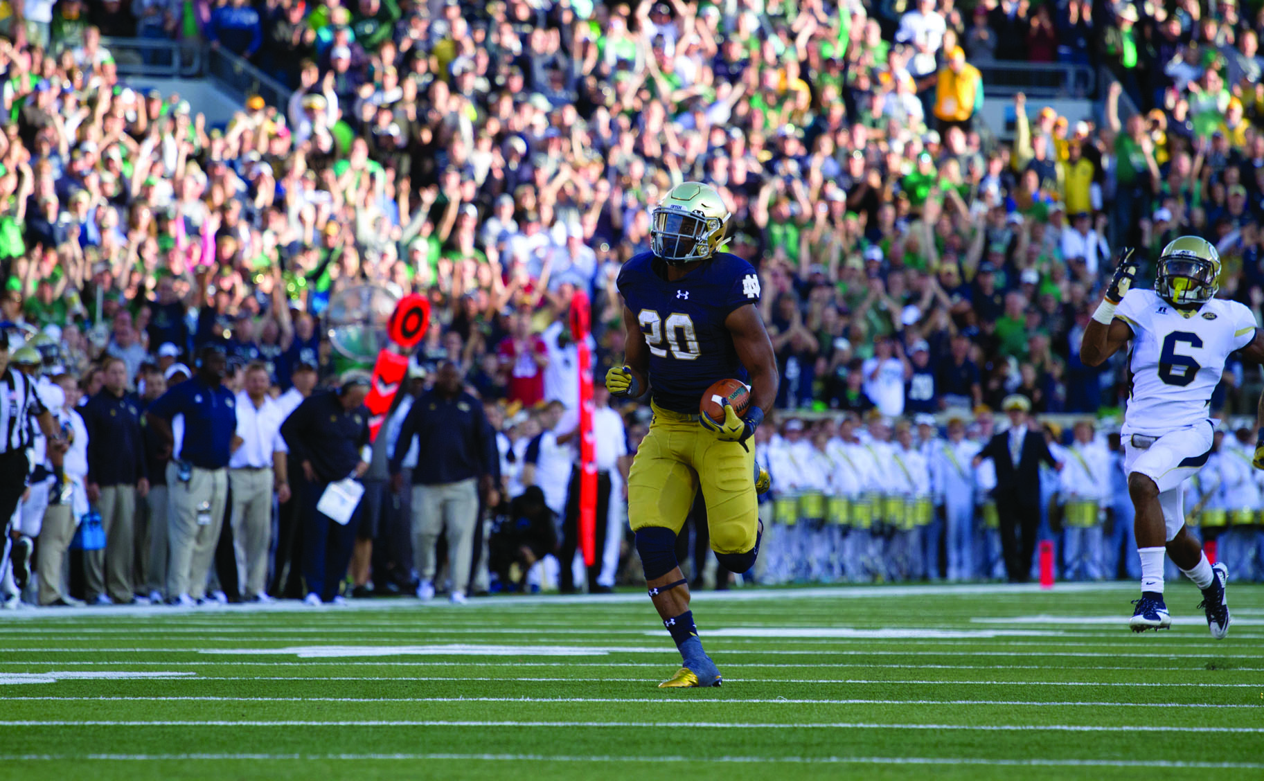 rish senior running back C.J. Prosise pulls away from Georgia Tech redshirt senior defensive back Chris Milton during his 91-yard touchdown run in the fourth quarter of Notre Dame's 30-22 win Saturday.