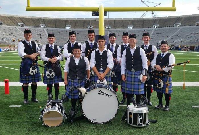 Photo courtesy of Dylan Klee  The Notre Dame Bagpipe Band poses in Notre Dame Stadium on Sept. 5 prior to the Texas game.