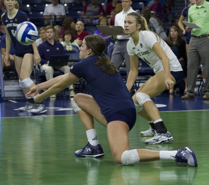Sophomore outside hitter Sydney Kuhn digs a ball during Notre Dame's 3-0 loss against Florida State on Sunday afternoon.