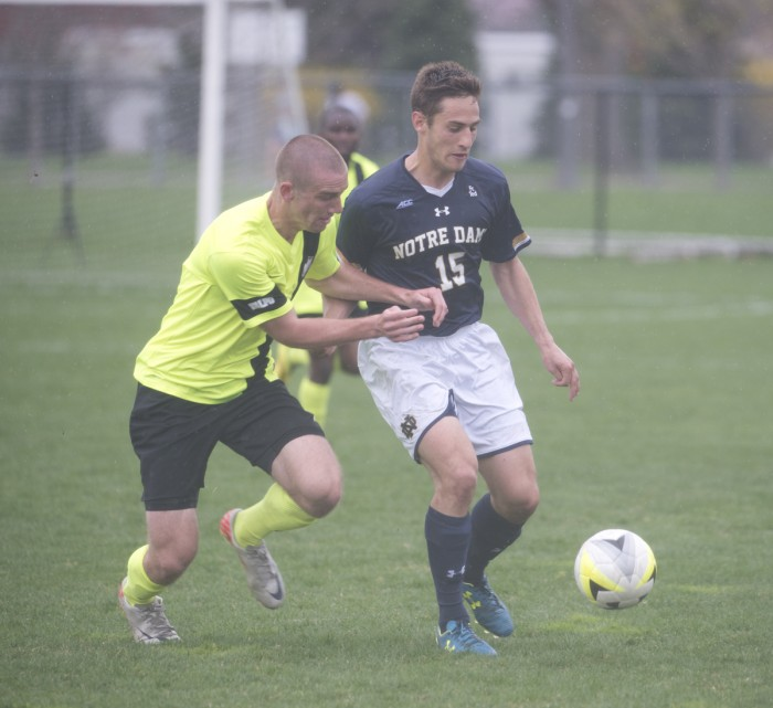 Senior midfielder Evan Panken dribbles away from a defender during a Spring exhibition game against Valparaiso on April 19. Panken had one goal in Friday's win against Virginia.