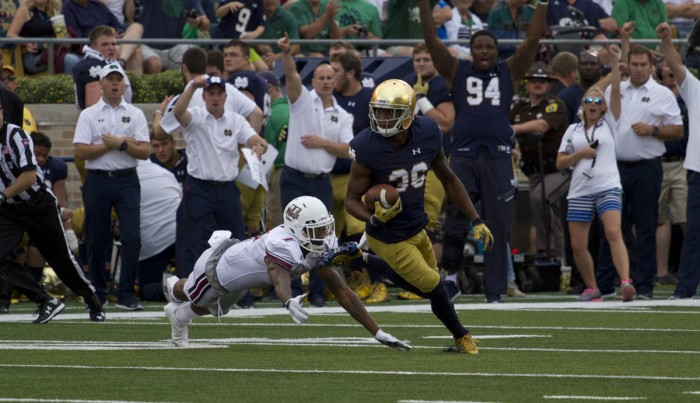 Junior cornerback Cole Luke looks upfield after his interception in Notre Dame's 62-27 win Saturday.