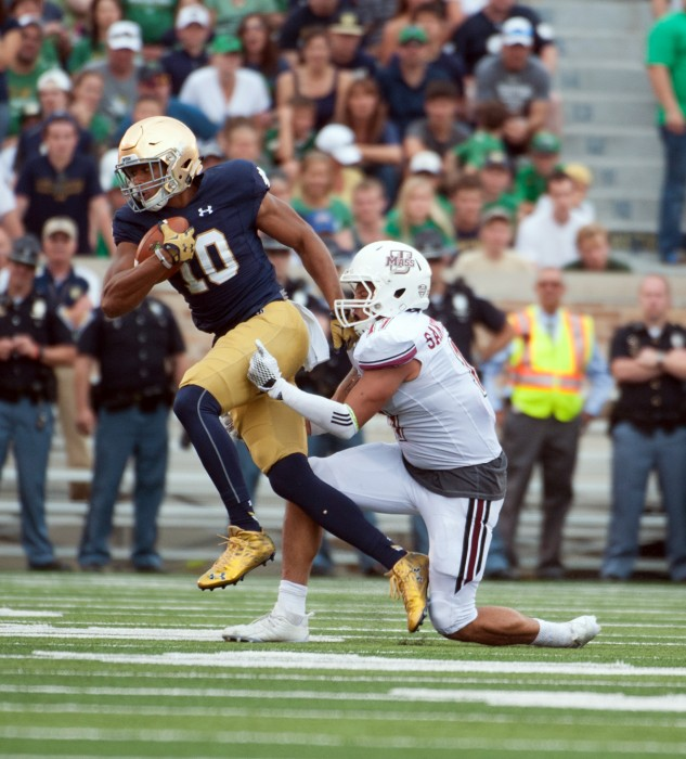 Freshman tight end Alizé Jones sheds a tackle during Notre Dame's 62-27 win over Massachusetts on Saturday at Notre Dame Stadium.