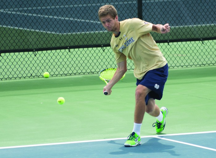 Irish senior Quentin Monaghan goes down after a forehand shot during Notre Dame's 4-3 win over North Carolina State on April 18 at Courtney Tennis Center.