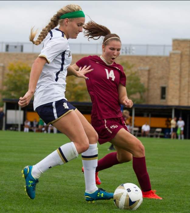 Freshman forward Natalie Jacobs dribbles the ball past the defender during Notre Dame's 1-0 overtime loss to Florida State at Alumni Stadium on Sunday.