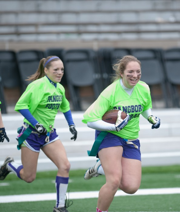 Pangborn seniors Katie Schultz, left, and Gracie Gallagher run onto the field before last year's interhall championship game.