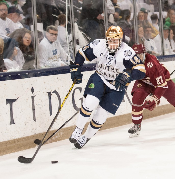 Senior center Thomas DiPauli skates along the boards during a 2-0 loss to Boston College on Feb. 28 at Purcell Pavilion. DiPauli totaled 8 goals and 21 assists last season.