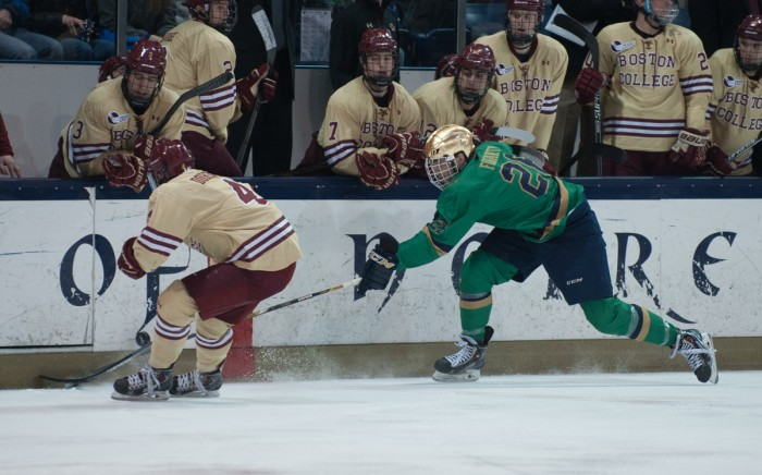 Senior center Steven Fogarty fights for a loose puck during a 2-0 loss to Boston College on Feb. 28 at Compton Family Ice Arena. Fogarty tallied nine goals and 12 assists during the 2014-2015 season.