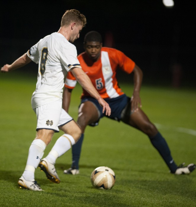 Sophomore  forward Jon Gallagher dribbles into a defender during a 3-1 victory over Virginia on Sept. 25 at Alumni Stadium.