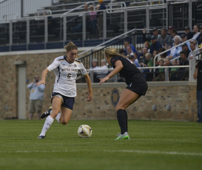 Irish senior forward Anna Maria Gilbertson attempts to get past a defender against during a win on Aug. 28 at Alumni Stadium.