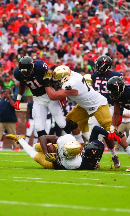 Irish graduate student offensive lineman Nick Martin makes a block during Notre Dame's 34-27 win over Virginia on Sept. 12.