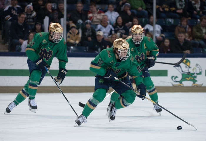 Sophomore left wing Anders Bjork carries the puck down the ice during Notre Dame's 3-1 victory over Boston College on Feb. 28 at Compton Family Ice Arena.