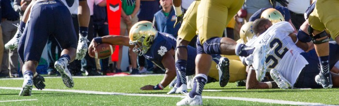 Irish sophomore quarterback DeShone Kizer stretches for the goal line during Notre Dame's 41-24 victory. Kizer was ruled short on the play after a review, but he scored on a quarterback sneak the very next play.