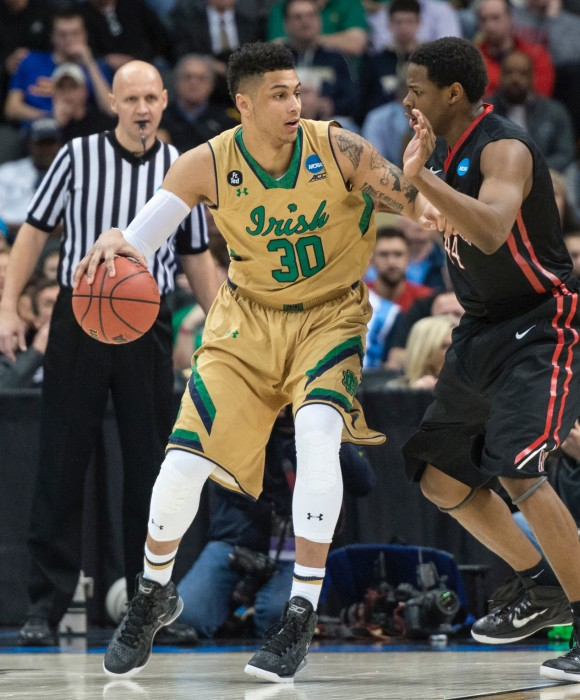 Irish senior forward Zach Auguste backs down his defender and surveys the court during Notre Dame's  69-65 win over Northeastern on March 19 at CONSOL Energy Center.