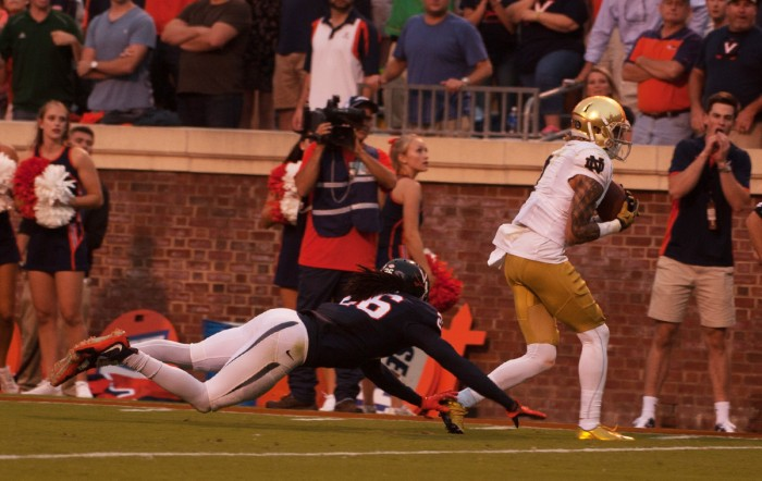 Irish junior receiver Will Fuller scores the game-winning touchdown in the final minute of Notre Dame's 34-27, come-from-behind win at Virginia on Sept. 12 at Scott Stadium in Charlottesville, Virginia.