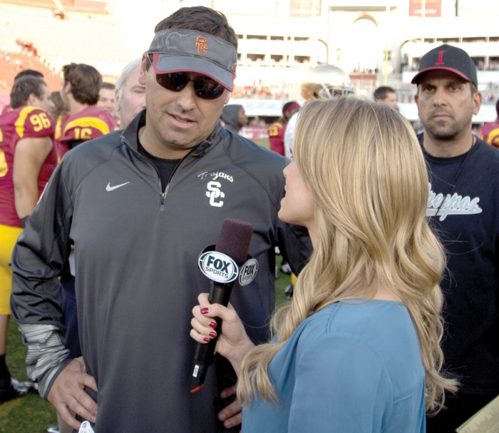 Former USC head coach Steve Sarkisian chats with a reporter following the Trojans' win over Notre Dame last year in Los Angeles. Sarkisian was fired Monday by USC athletic director Pat Haden.