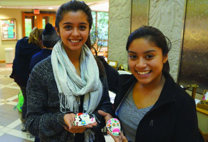 Saint Mary's students celebrate Dia de los Muertos with La Fuerza, a Hispanic cultural club, by decorating candy skulls.
