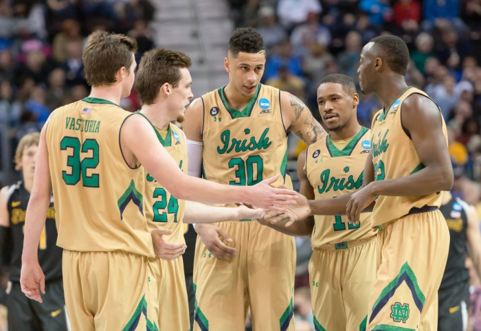 The 2014-2015 men's basketball team hudles up during an 81-70 victory over Wichita State on March 26 in Cleveland, OH. The Irish advanced to the Elite Eight with the win.