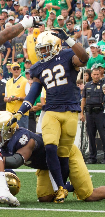 Irish senior safety Elijah Shumate reacts to a goal-line stand during Notre Dame's 62-27 home victory over Massachusetts on Sept. 26.