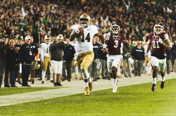 Irish sophomore quarterback DeShone Kizer runs away from the Temple defense on his 79-yard touchdown run in the second quarter of Notre Dame's 24-20 win against Temple on Saturday in Philadelphia. Kizer became the second Irish quarterback to throw for 200 yards and rush for 100 in a single game in his three-touchdown performance.