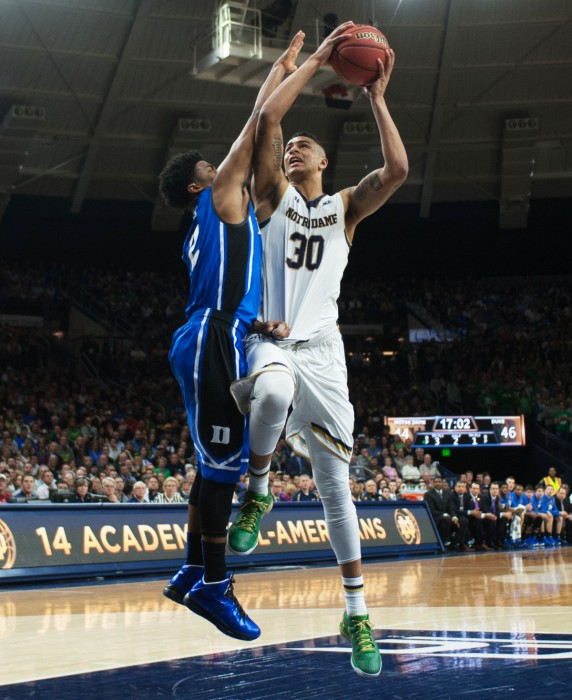 Senior forward Zach Auguste drives the lane during the Irish victory over Duke on Jan. 28 at Purcell  Pavilion. The new season begins next week after a final exhibition tilt against Caldwell on Thursday.